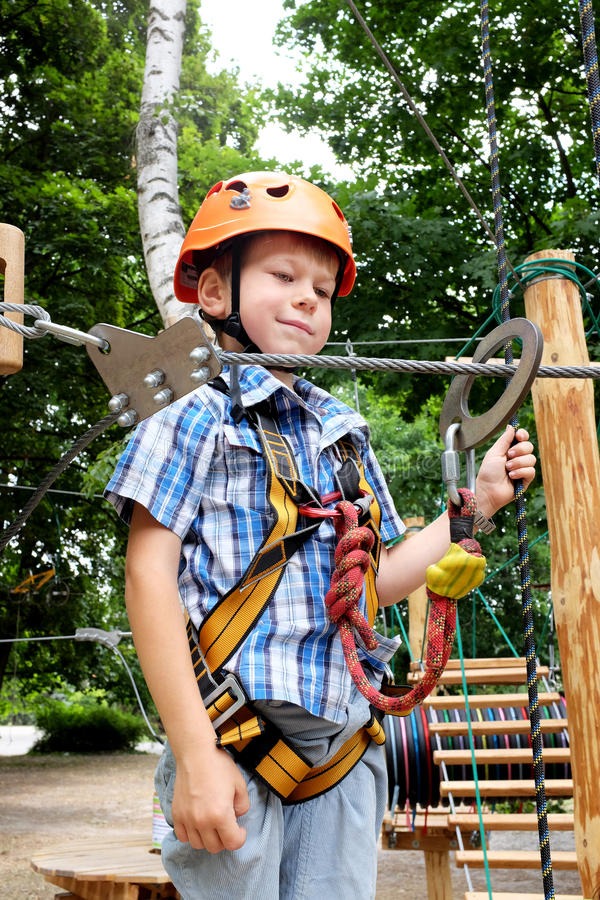 Boy in rope park royalty free stock photo