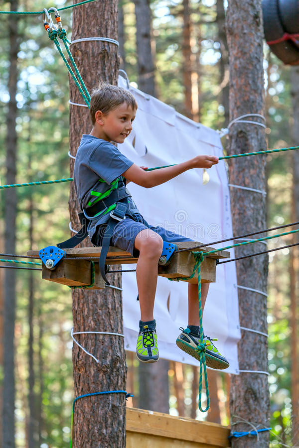Boy on the ropes course Attractions (01) stock photography