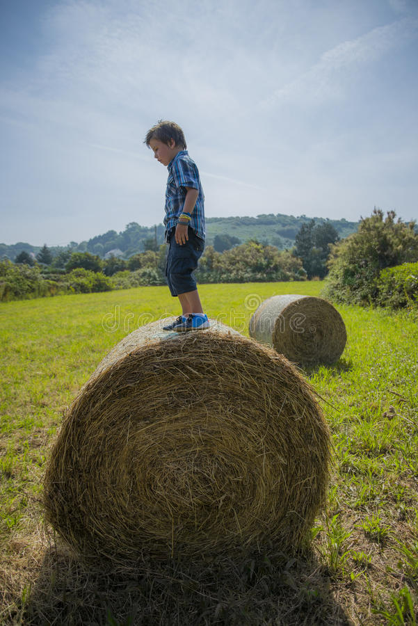Download Boy on round hay bale stock photo. Image of urban, scene - 32549832