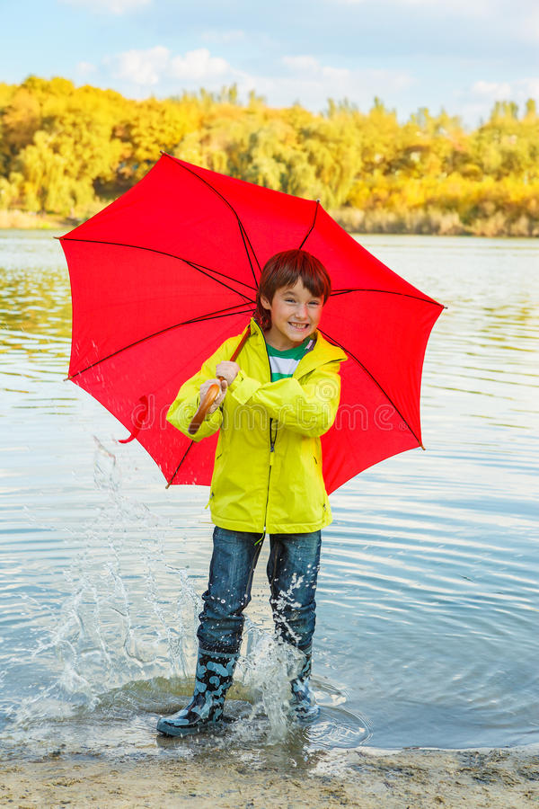 Boy in rubber boots royalty free stock images