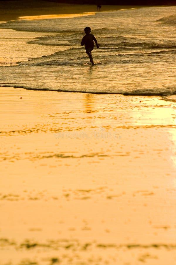 Boy Running at the beach. Noosa Beach, Australia stock images