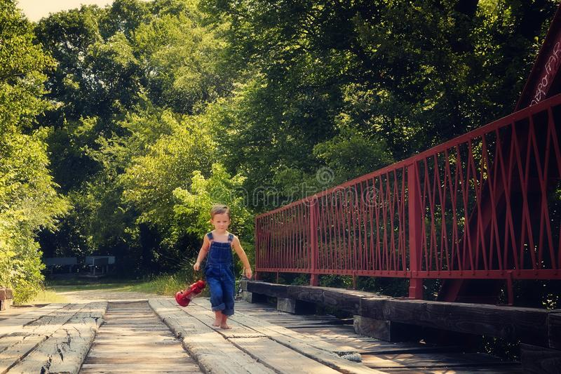 Boy running with lantern on red. Farm boy chicken profile thinking royalty free stock photography