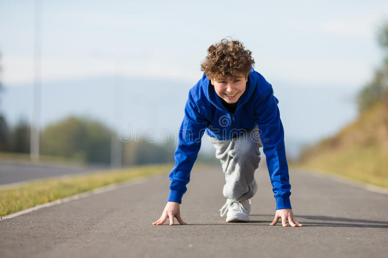 Boy running outdoor royalty free stock photo