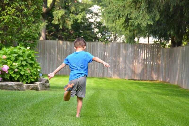 Boy running outside stock photos
