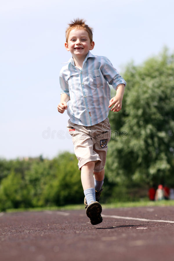 Download Boy runs in a summer park stock photo. Image of full - 14878348