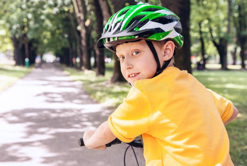 Boy in safe helmet on bicycle royalty free stock image