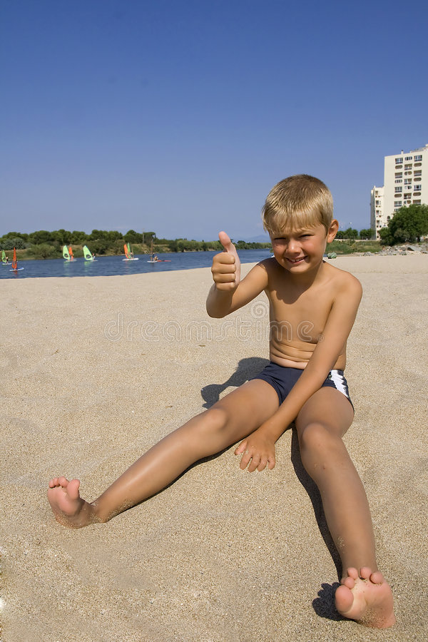 Boy in sand stock image