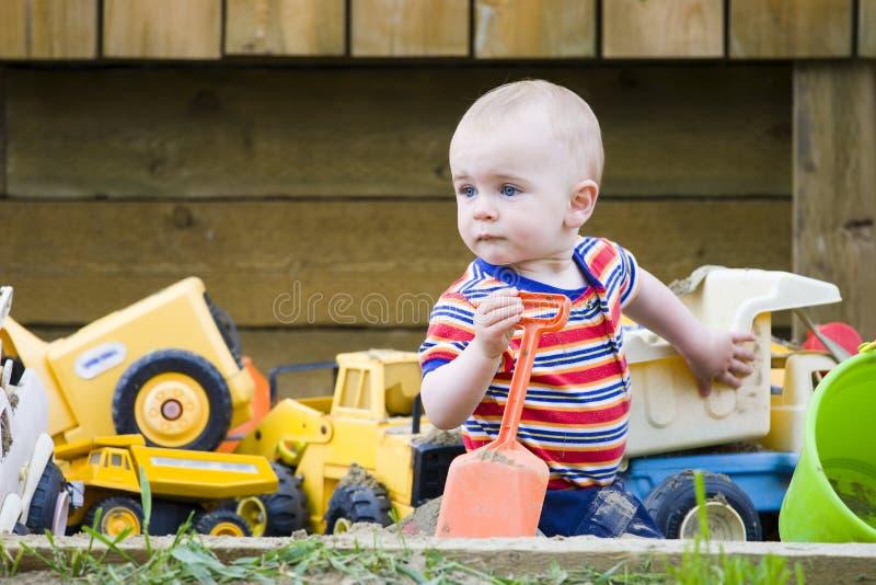 Boy in sandbox royalty free stock photos