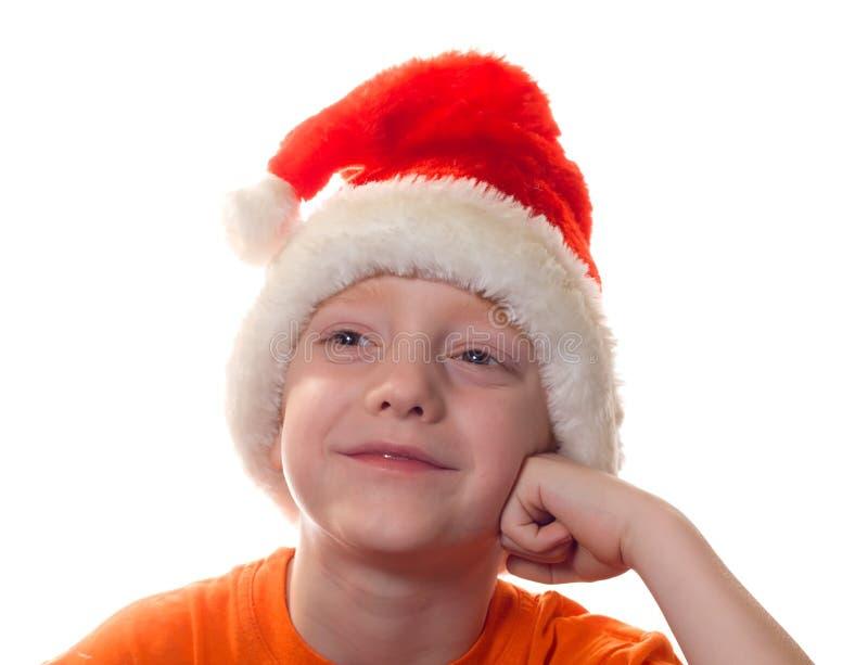 Boy in Santa cap stock images