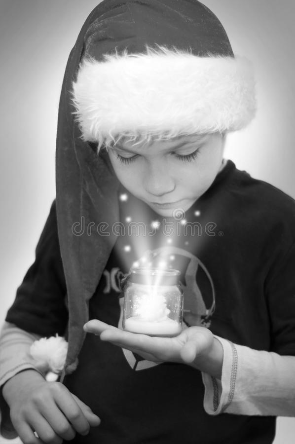 Boy in Santa's hat with magical gift royalty free stock photography