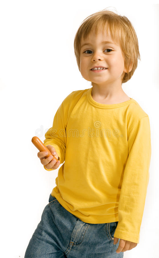 Boy with a sausage stock photography