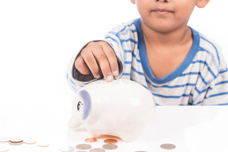 boy saving money in piggy bank royalty free stock image