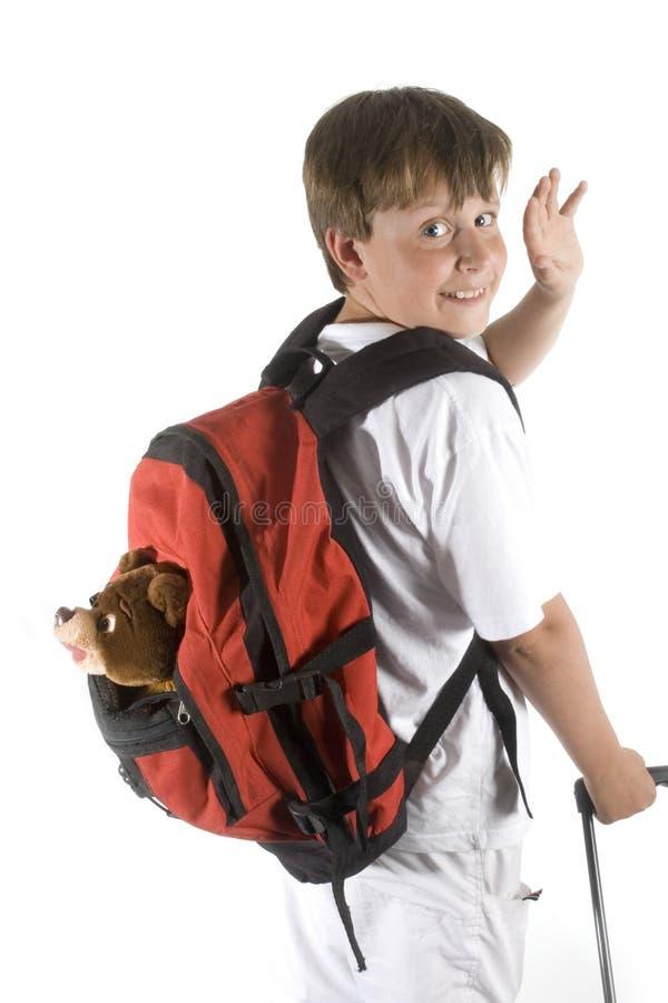 Boy is saying goodbye stock photo