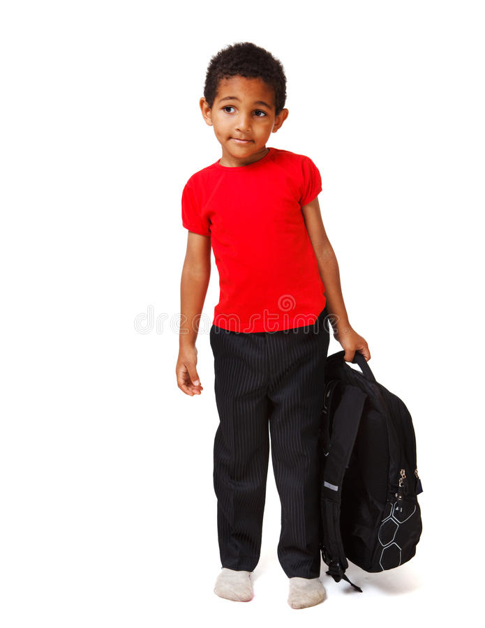 Boy with a school backpack stock photo