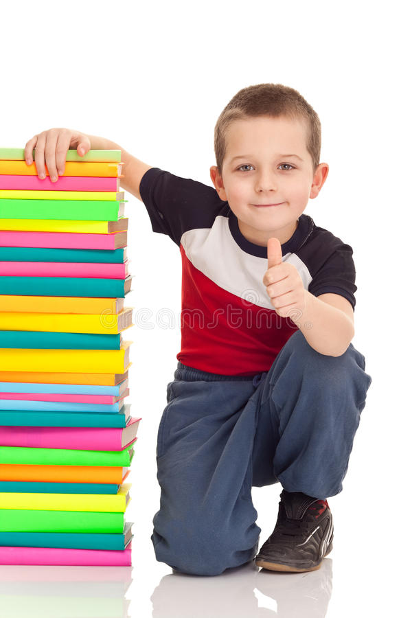 Boy with school books stock images