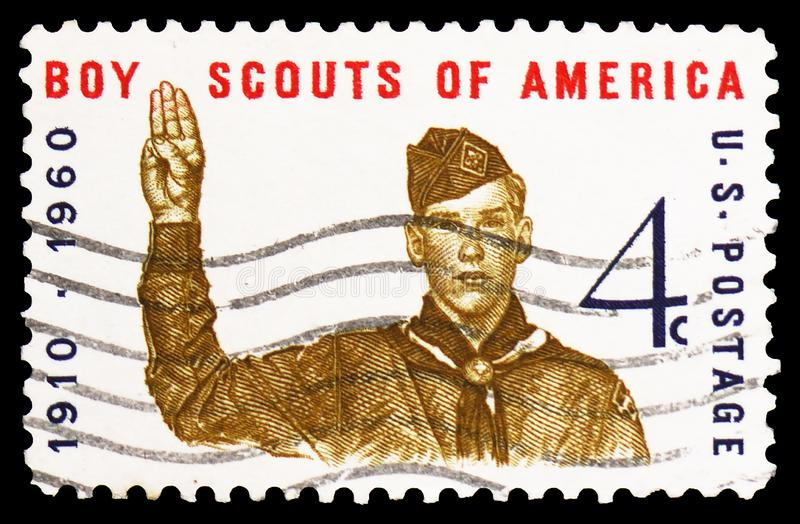 Boy Scout giving scout sign, 50th anniversary of Boy Scouts, serie, circa 1960. MOSCOW, RUSSIA - FEBRUARY 22, 2019: A stamp printed in United States shows Boy stock photo