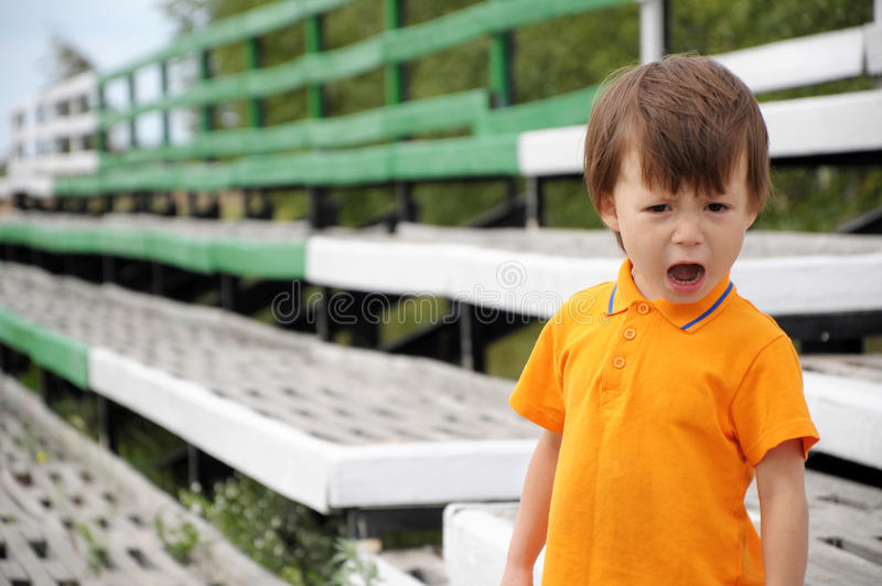 Boy screaming. In discontent, outdoor, summer time stock image