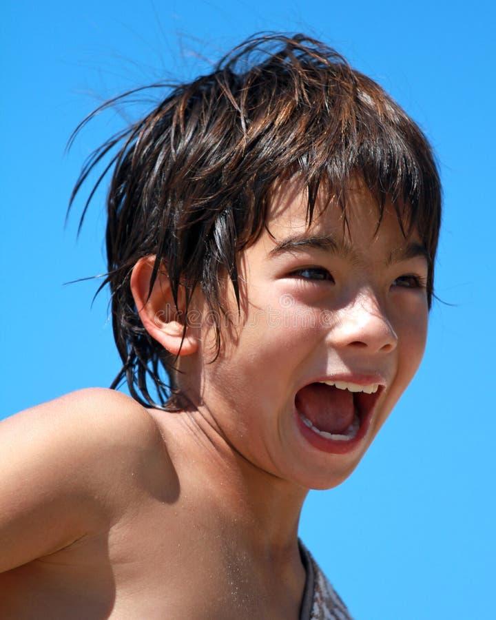 A Boy Screams And Smiles Stock Photos