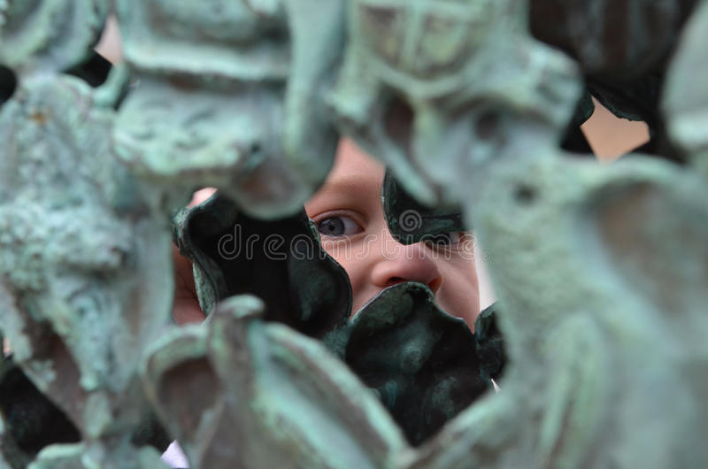 A boy and sculpture stock photography