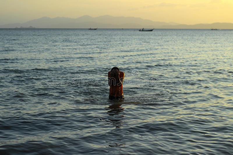 The boy in the sea stock images