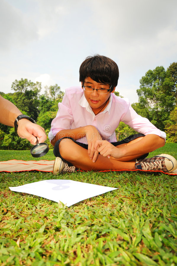 Boy searching for clues royalty free stock photos