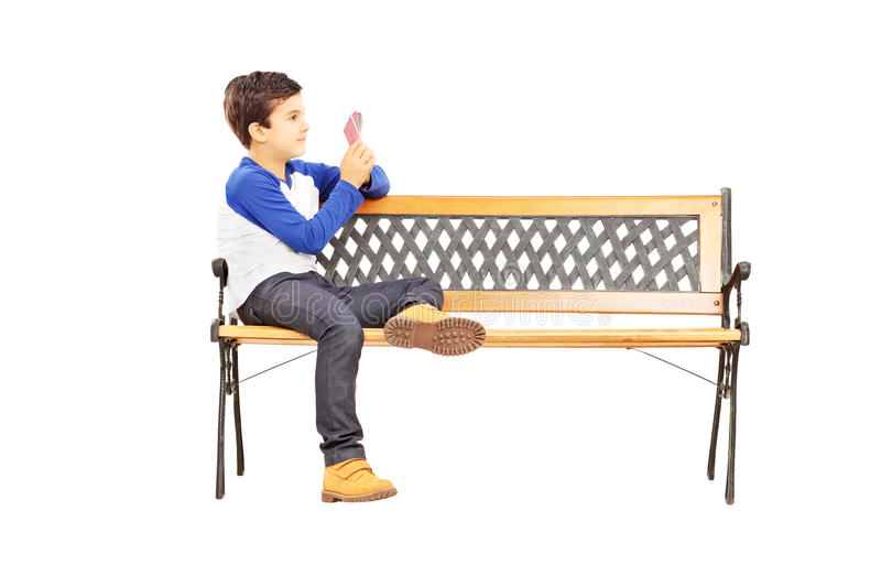 Download Boy Seated On Bench And Playing Cards With Imaginary Friend Stock Image - Image: 37088157