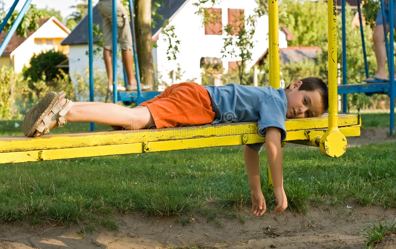 Download Boy on the seesaw stock image. Image of garden, summer - 19515065