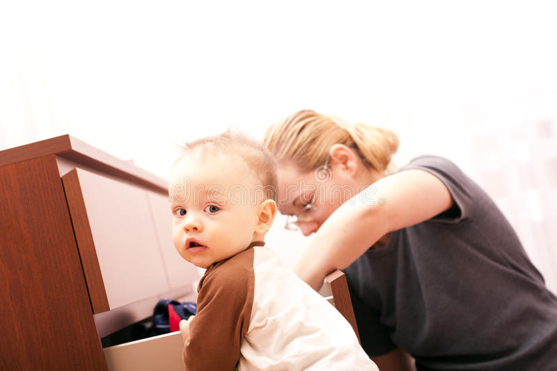 Boy In The Selection Of Clothes With Her Mother. Stock Image