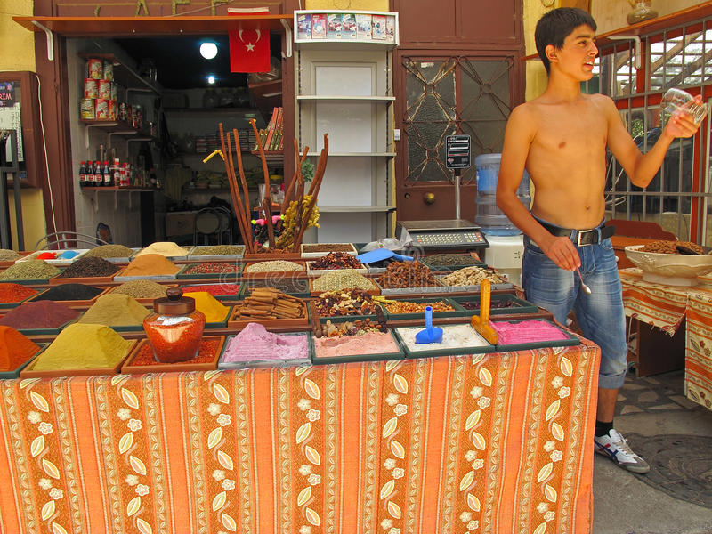 Boy selling spices at market royalty free stock photos