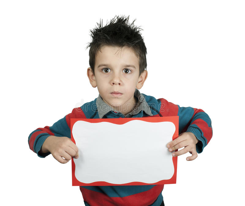 Boy with serious look who holds white board. royalty free stock images