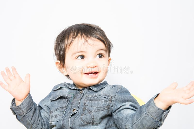Boy in a shirt is ready to applaud what will happen. A boy in a shirt is ready to applaud what will happen royalty free stock photography