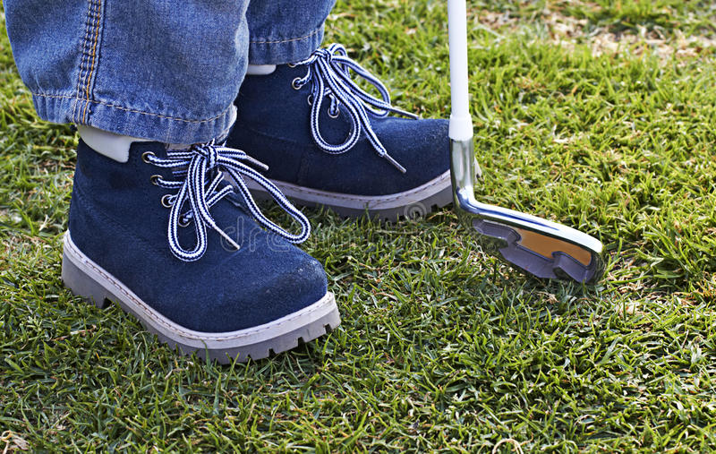 Download Boy Shoes And Golf Club On Grass Stock Photography - Image: 21102352