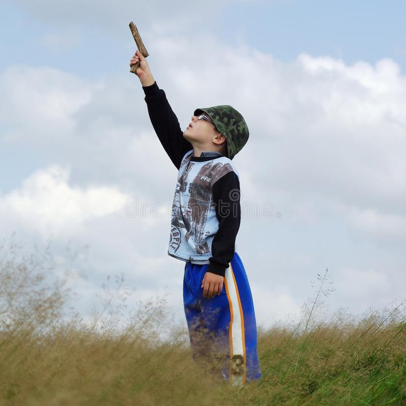 Download Boy shoot into air. stock photo. Image of little, shooting - 12950696