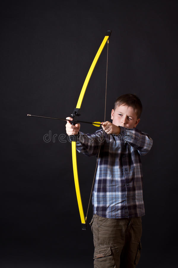 Download Boy shoots a bow stock image. Image of youth, arrow, leisure - 28231023