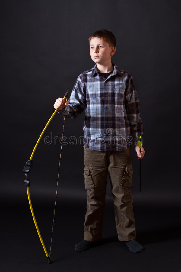Boy shoots a bow
