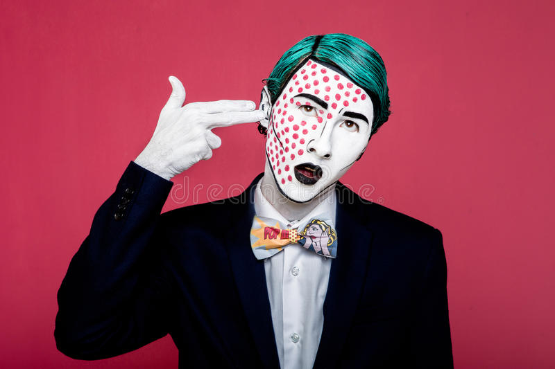 Boy shoots himself in the style of pop art royalty free stock photo