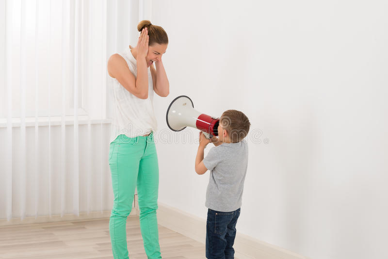 Boy Shouting At Her Mother royalty free stock image