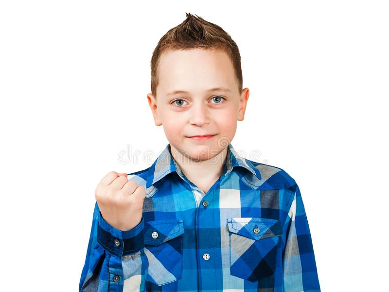 Boy show his fist with serious face. Isolated on white background. Boy show fist with serious face. Isolated on white background royalty free stock photos
