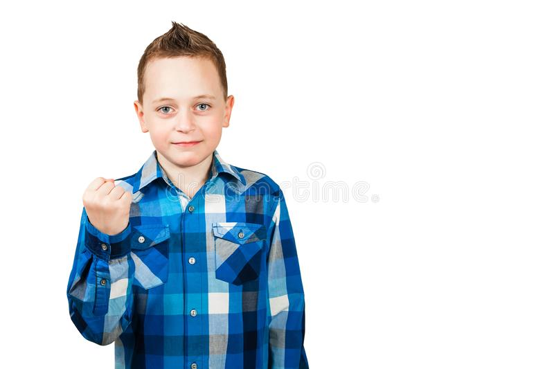 Boy show his fist with serious face. Isolated on white background. Boy show fist with serious face. Isolated on white background stock image