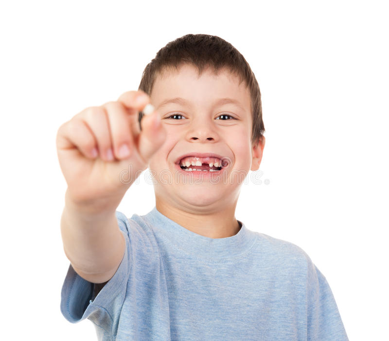 Boy show a lost tooth. On white royalty free stock images
