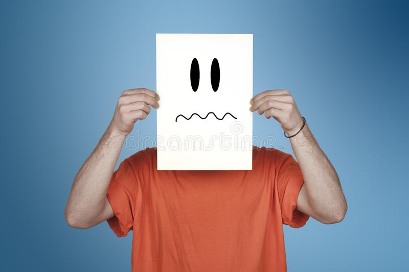 Download Boy Showing A Blank Paper With A Disgusted Emoticon Stock Image - Image: 29901687