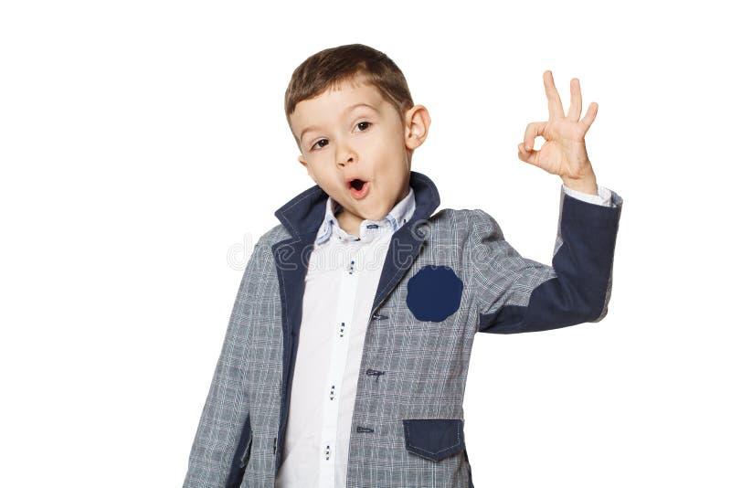Boy showing OK. Little boy showing OK sign isolated on white background stock photos