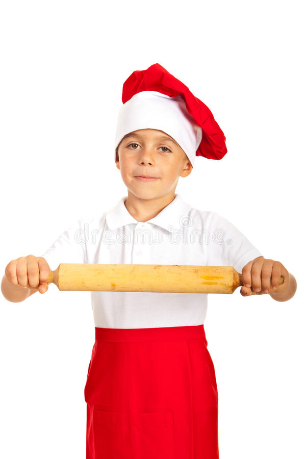 Boy showing rolling pin stock photography