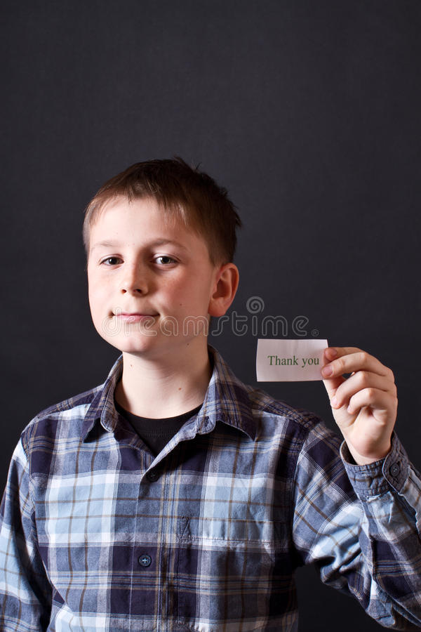 Boy shows a card with gratitude royalty free stock photography