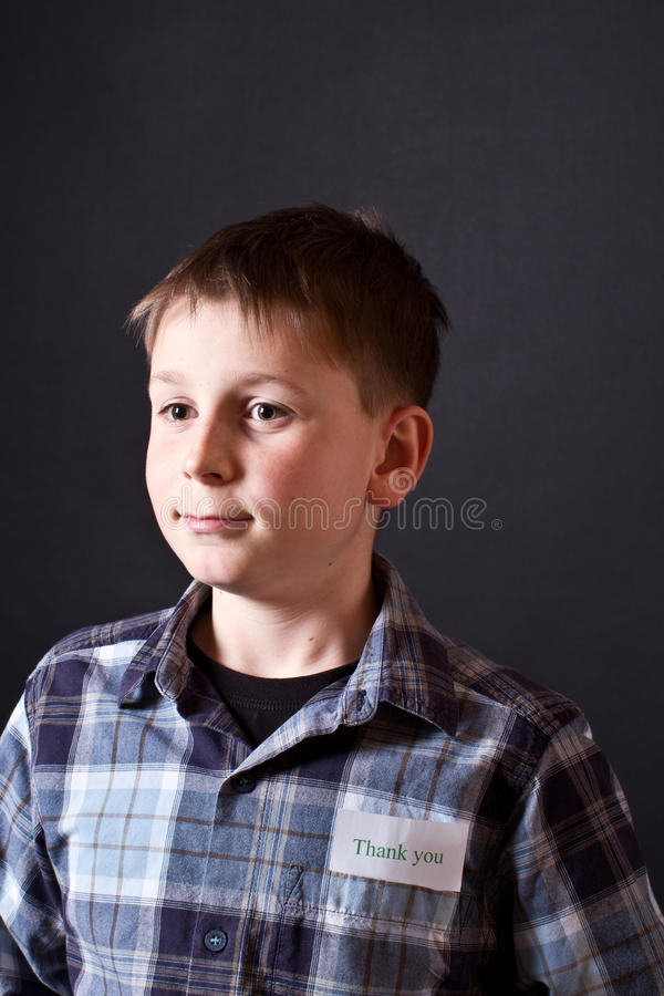 Boy shows a card with gratitude royalty free stock image