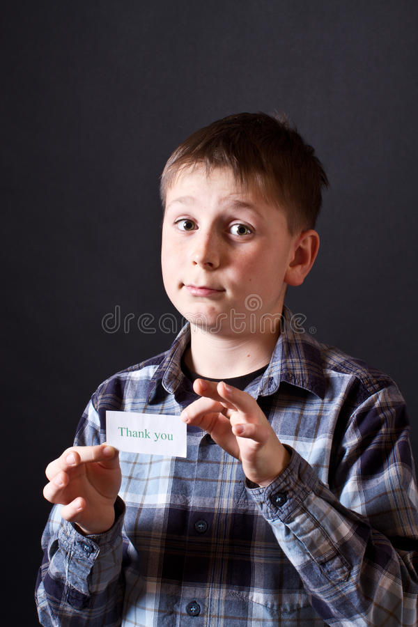 Boy shows a card with gratitude stock images