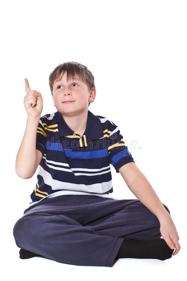 Boy shows his finger stock photos