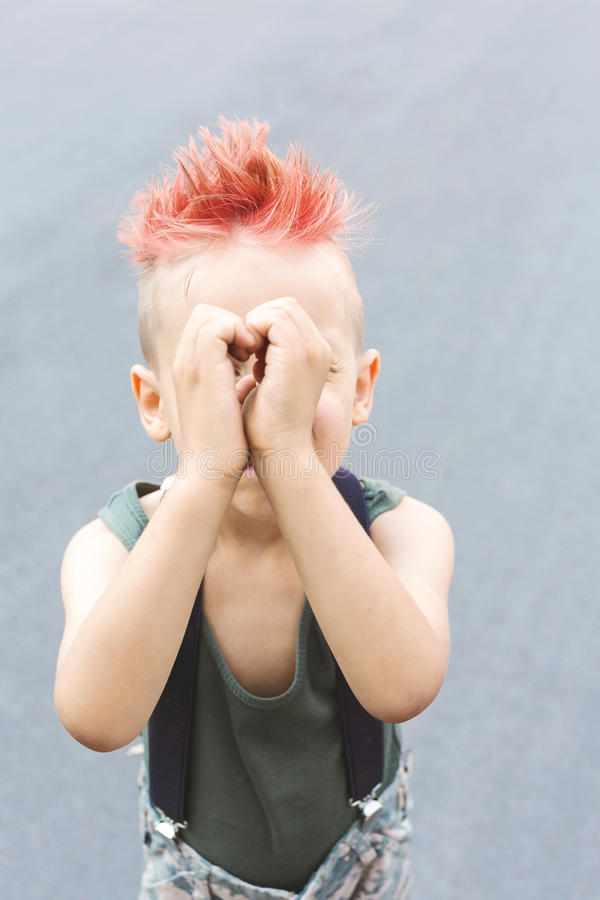 Download A Boy Shows His Heart With His Hands. A Little Boy With Red Hair. Child In Uniform. The Child Indulges, Croaks. Stock Photo - Image of childhood, little: 98391292