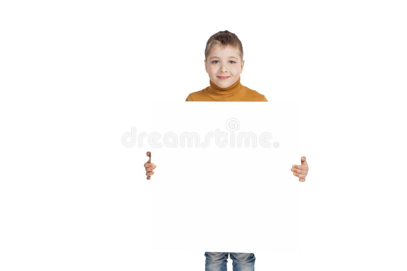 Boy with a sign insulated. A boy in light brown clothes with a sign insulated royalty free stock images