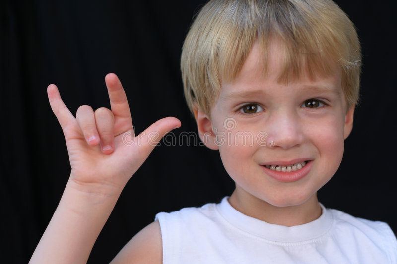 Boy Signing I Love You. Young boy making sign for I Love You in ASL ( American Sign Language stock photos